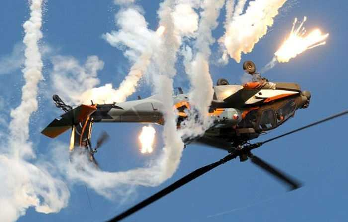 AH-64D Apache Doing Barrel Rolls Royal Netherlands Air Force AH-64D Apache Demo Team pictures gfdgdf