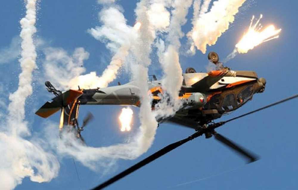 AH-64D Apache Doing Barrel Rolls Royal Netherlands Air Force AH-64D Apache Demo Team video featured