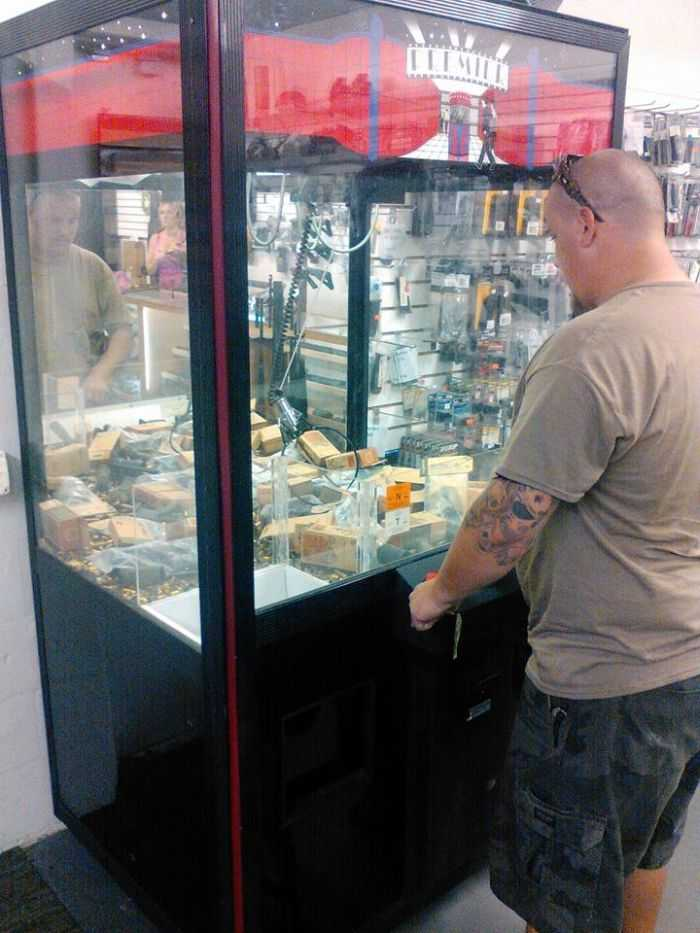 Gun Store Installs Claw machine Full Of AR Parts And Ammo pictures 002