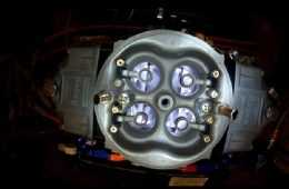 Overhead View Of A Holley 4 Barrel Carburetor On An Engine Dyno featured