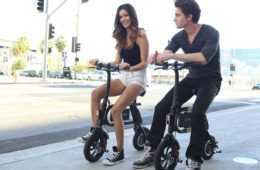 Two Models Posing On the SwagCycle