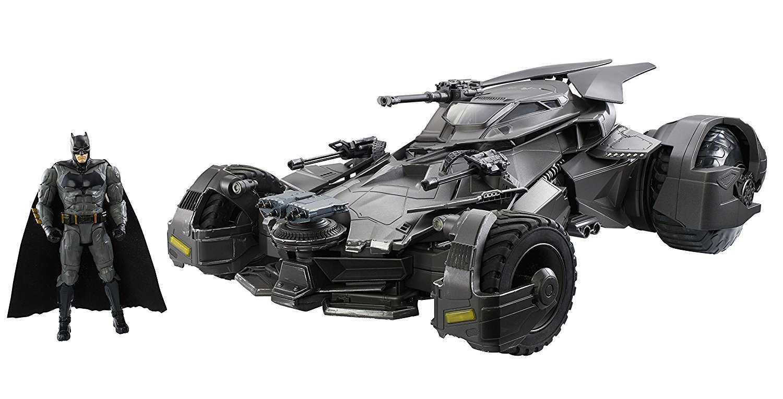Batman Action Figure Standing Besides the Ultimate Justice League Batmobile