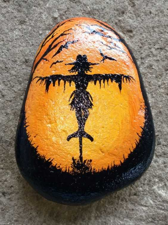 Halloween Painted Rocks - Scarecrow With Orange Glow