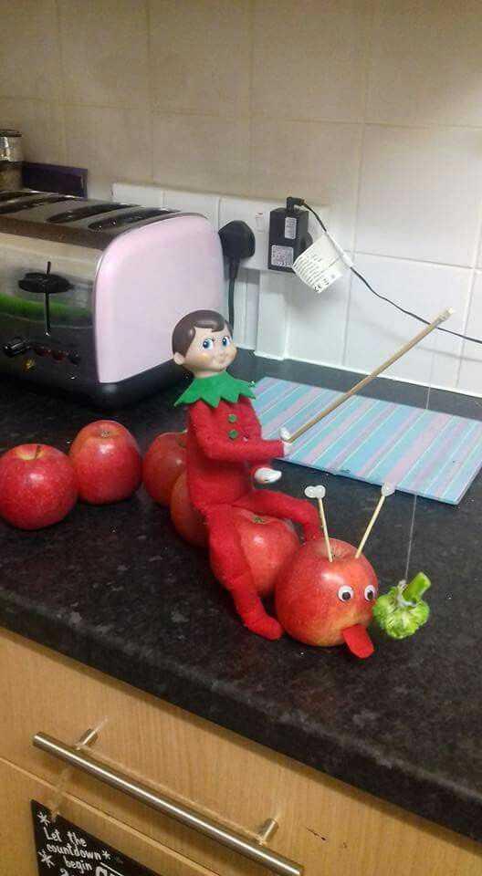 elf on a shelf  - apple caterpillar