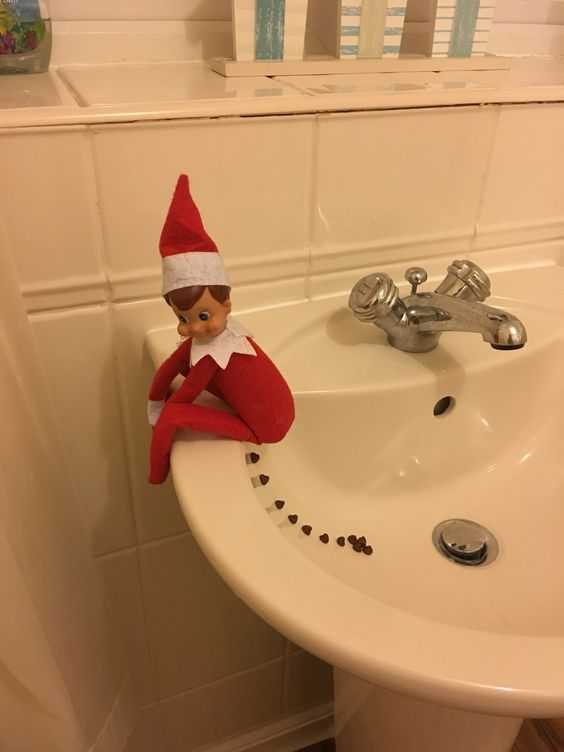 elf on a shelf - leaving some droppings in the sink