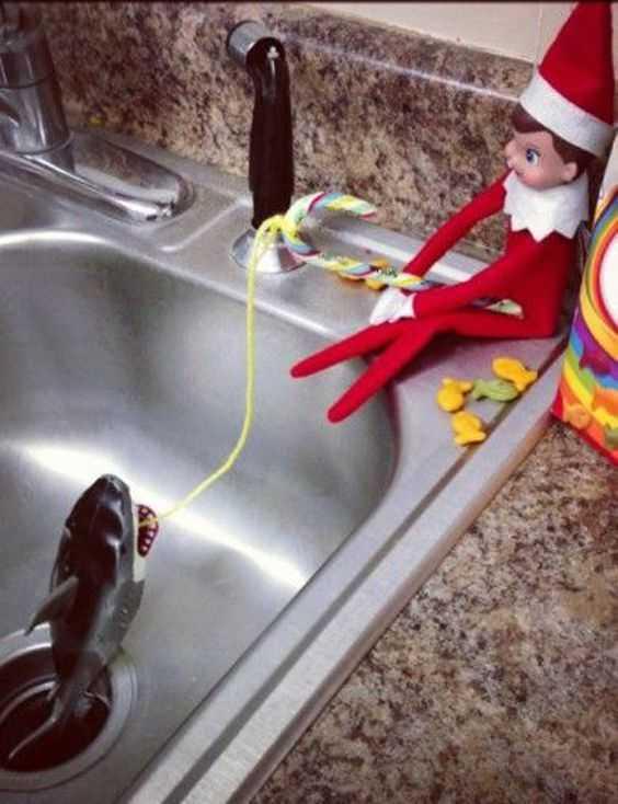 Elf On the Shelf kitchen - fishing for shark in kitchen sink