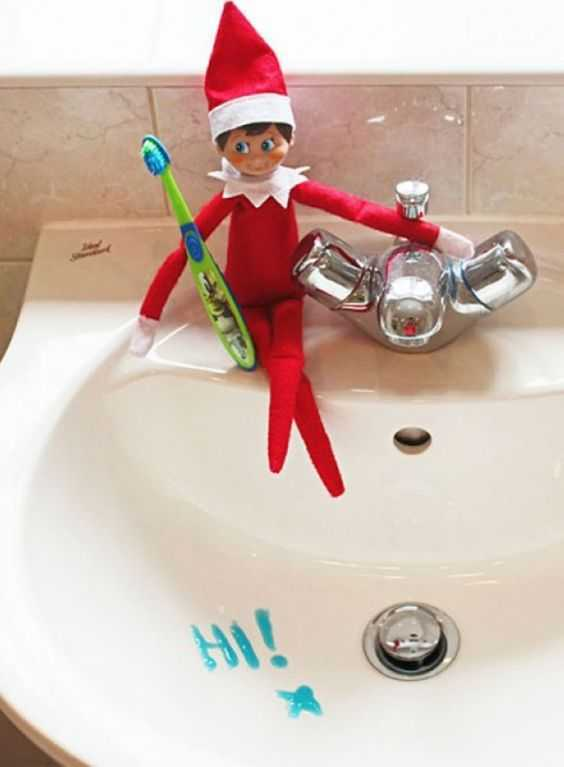 Elf On the Shelf accessories - toothbrush with hi written in toothpaste