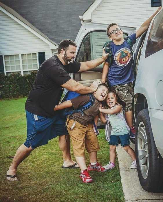 meme showing a dad trying to stuff his kids into the car while his kids try to resist