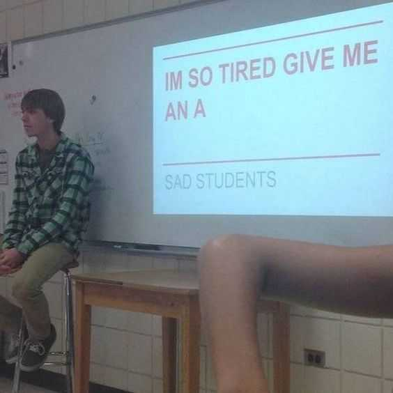 student meme of a student sitting in front of a projector captioned i'm so tired give me an a