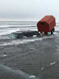 Truck submerged in iced over lake