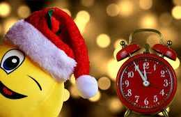 a santa emoji next to a clock ticking down to midnight