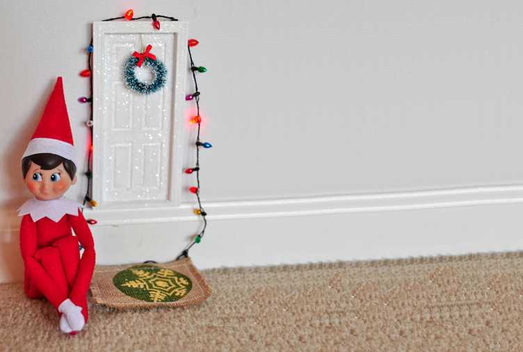 clever elf on the shelf ideas - decorated his own door