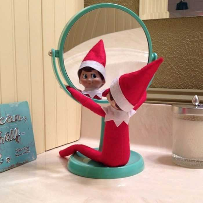 clever elf on the shelf ideas - staring in the mirror