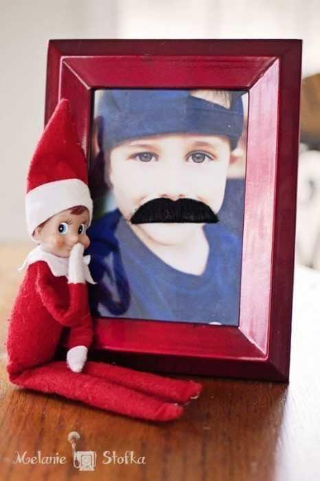 clever elf on the shelf ideas - graffiti moustache