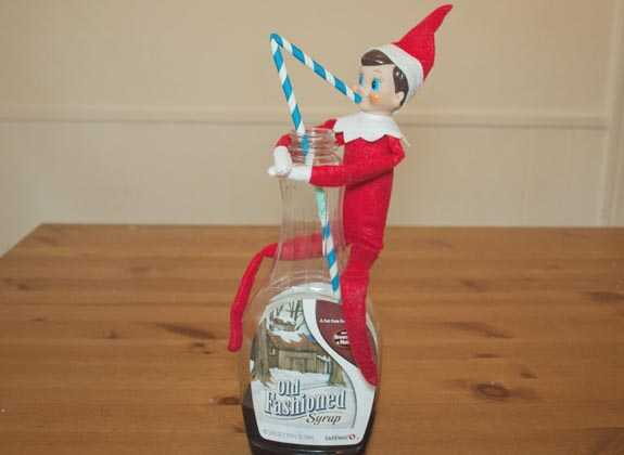 clever elf on the shelf ideas - drinking maple syrup with a straw