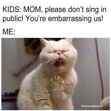 funny cat pictures - cat imitating mom singing