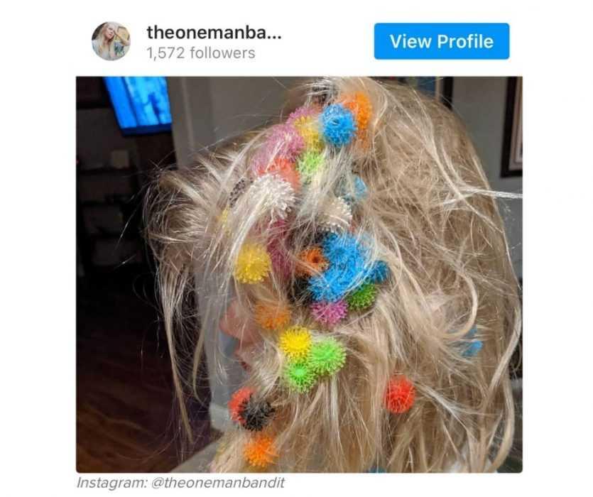 Work From Home Fails - Child Puts Plastic Coronavirus Replicas In Hair