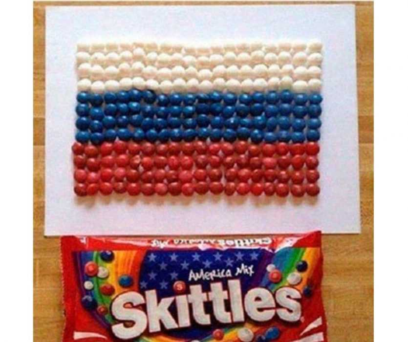 a russian arranging america mix skittles into a russian flag