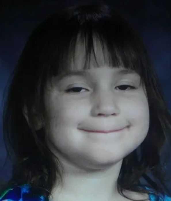 school picture meme of this kid who looks like she's plotting her revenge