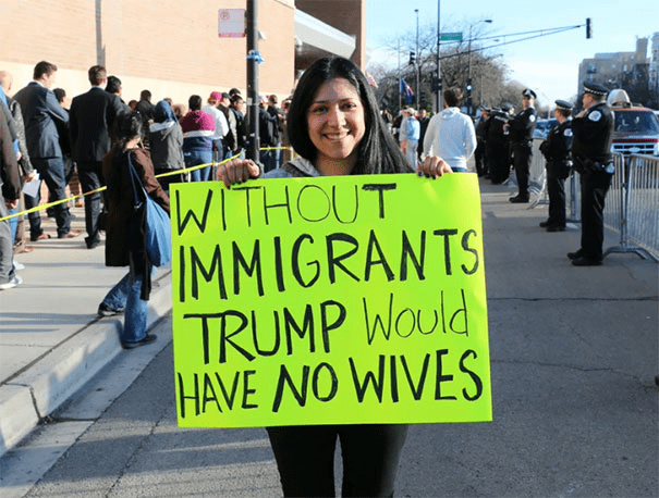 funny protest signs - no immigrants no wives