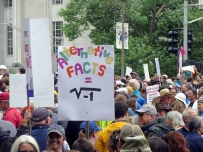 funny protest signs - alternative facts are imaginary